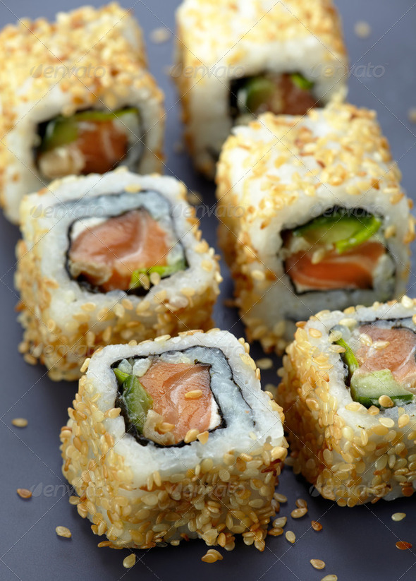 sushi with salmon and cucumber with sesame seeds - Stock Photo - Images