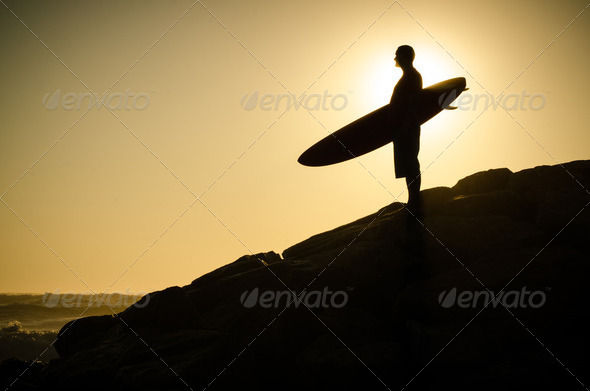 A surfer watching the waves - Stock Photo - Images