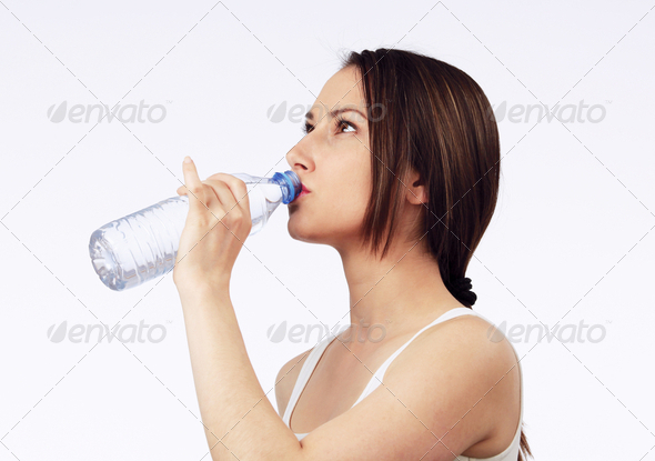 Young woman drinking water - Stock Photo - Images