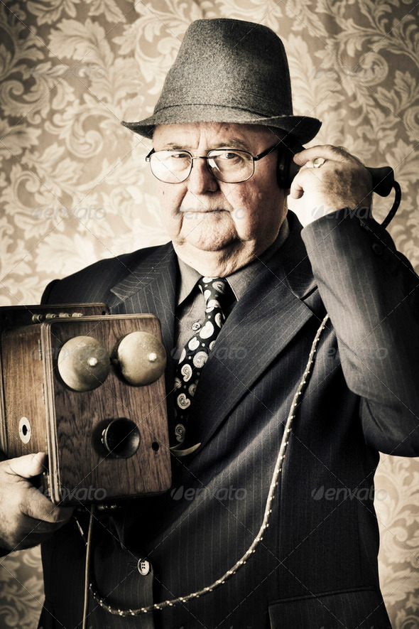 Vintage business man using retro telephone - Stock Photo - Images