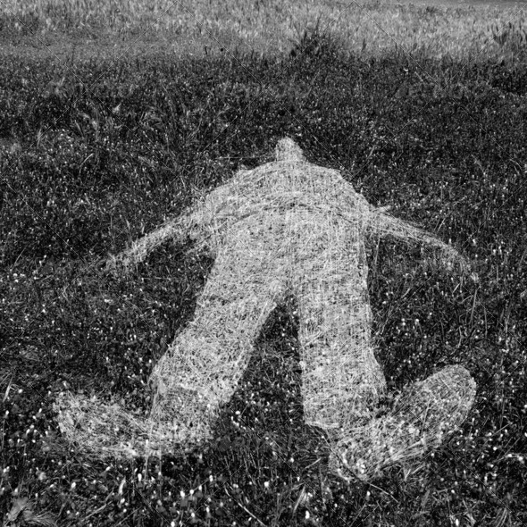 human figure outline imprinted on grass - Stock Photo - Images