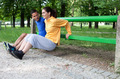 Happy young couple exercising outdoors, using a park bench to do - PhotoDune Item for Sale