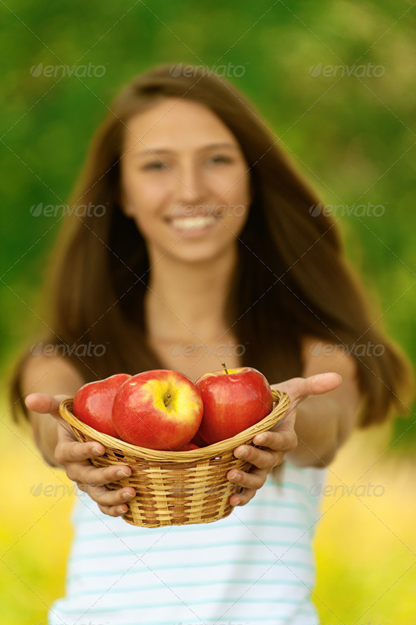 woman holding basket with apples - Stock Photo - Images