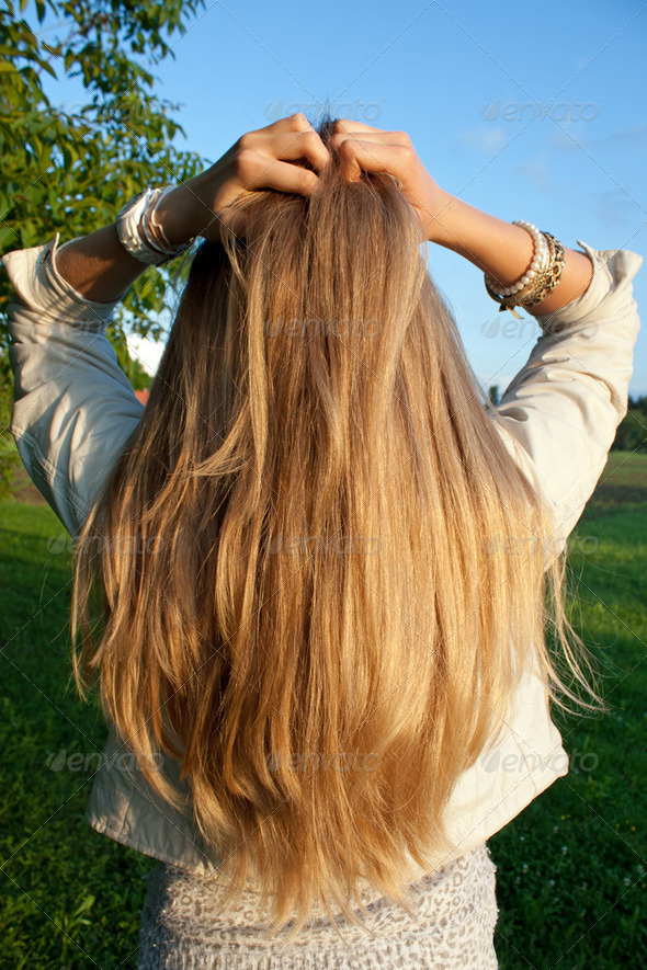 Young woman with helthy, long, blond hair - Stock Photo - Images