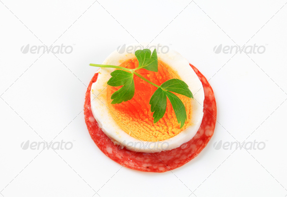 Slice of salami and boiled egg - Stock Photo - Images