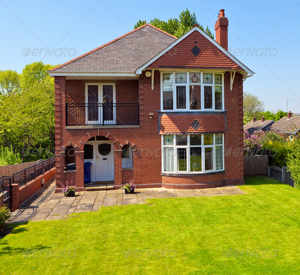 A new house with a garden - Stock Photo - Images