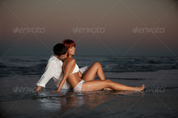 happy, romantic couple, by the sea shore - Stock Photo - Images