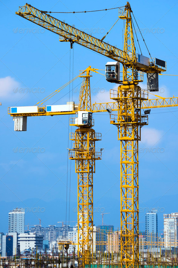 Cranes on construction site - Stock Photo - Images