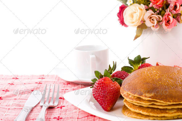 Pancake and strawberry have maple syrup on top with coffee - Stock Photo - Images