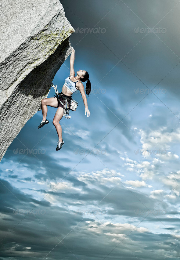 Rock climber clinging to a cliff. - Stock Photo - Images
