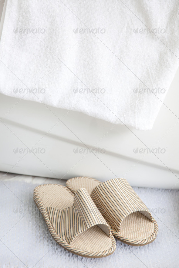 slippers and bath towel by the bathtub - Stock Photo - Images