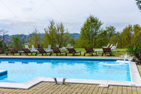 At the poolside into the green - Stock Photo - Images
