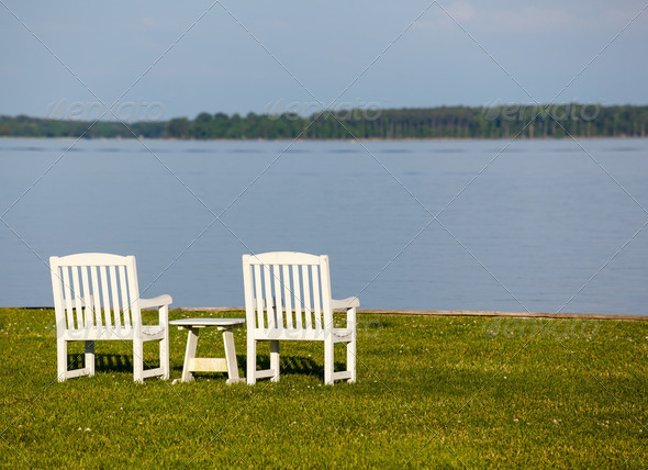 Pair of garden chairs by Chesapeake bay - Stock Photo - Images