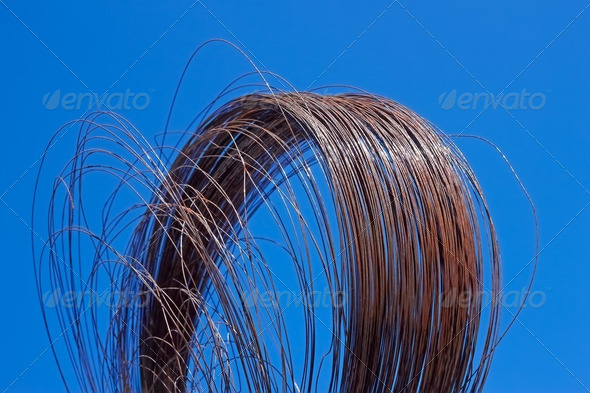 Rusty wire against blue sky - Stock Photo - Images