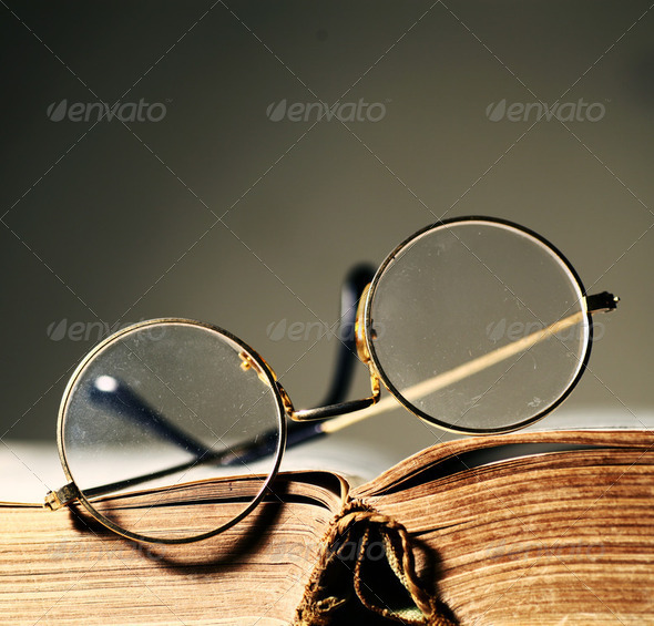 Old book with Eye glass - Stock Photo - Images