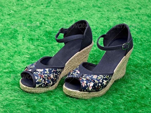 Female shoes in fashion concept on grass - Stock Photo - Images