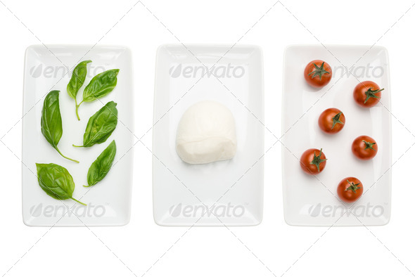 Italian food like flag, basil mozzarella tomato on white - Stock Photo - Images