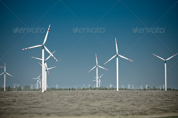 Wind turbine farm on rural terrain - Stock Photo - Images