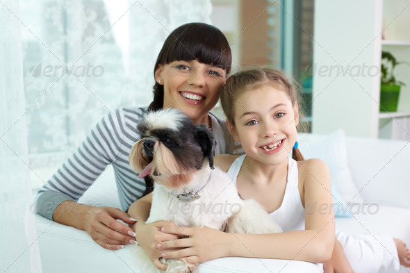 Mother, daughter and pet - Stock Photo - Images