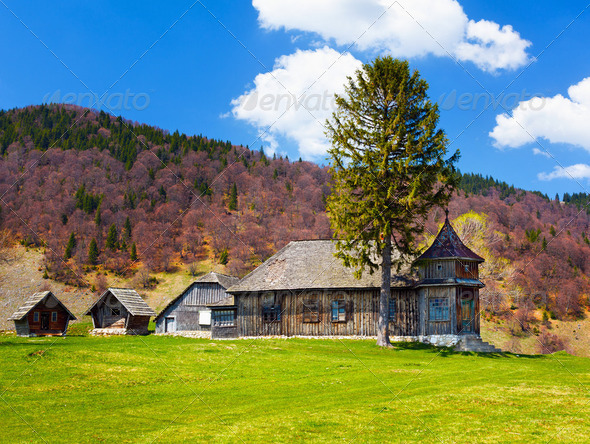 Wooden house and mountains - Stock Photo - Images