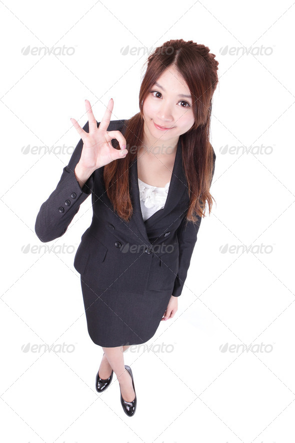 Perfect - business woman showing OK hand sign - Stock Photo - Images