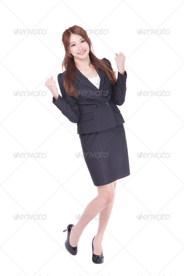 Business woman celebrating happy cheerful - Stock Photo - Images