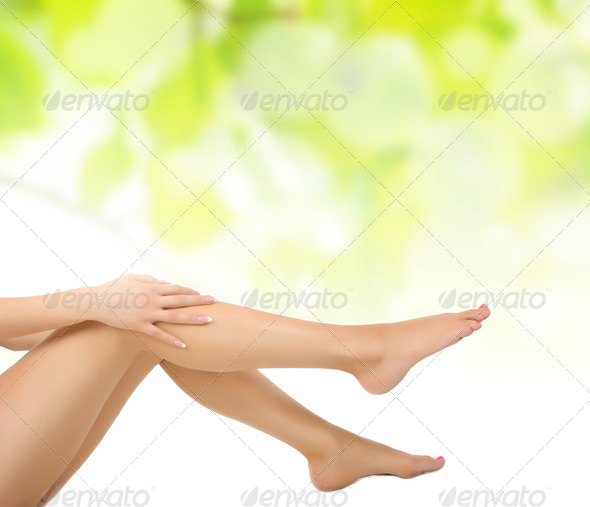 legs being massaged with hands - Stock Photo - Images