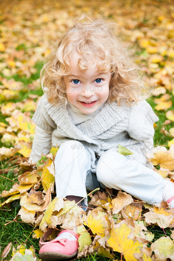 Child playing in autumn park - Stock Photo - Images