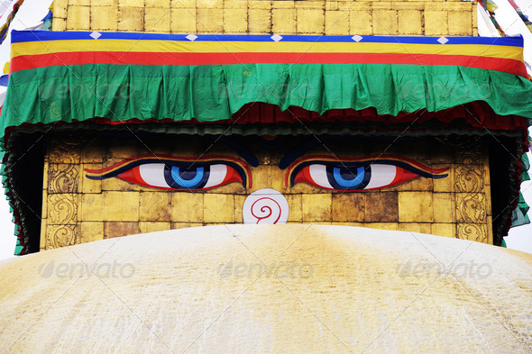 Huge Buddha eyes on the famous historic golden pagoda in Nepal - Stock Photo - Images