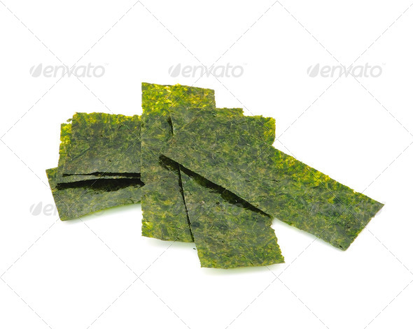Pieces of seasoned dried seaweed isolated on white - Stock Photo - Images