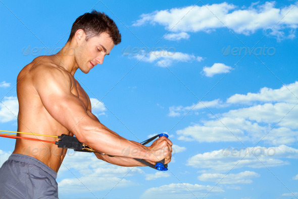 Handsome man doing exercises - Stock Photo - Images