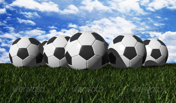 Soccer ball on a green grass - Stock Photo - Images
