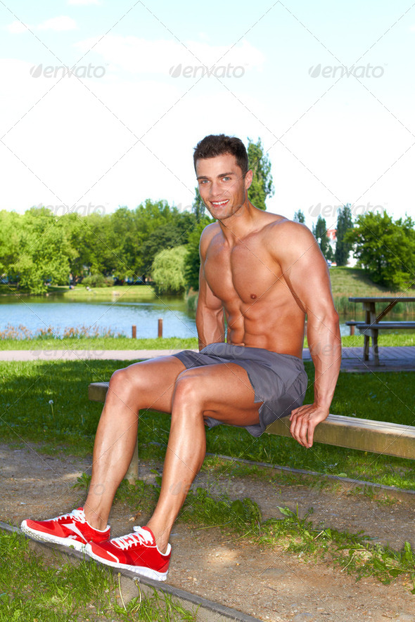 Handsome man doing exercises in park - Stock Photo - Images