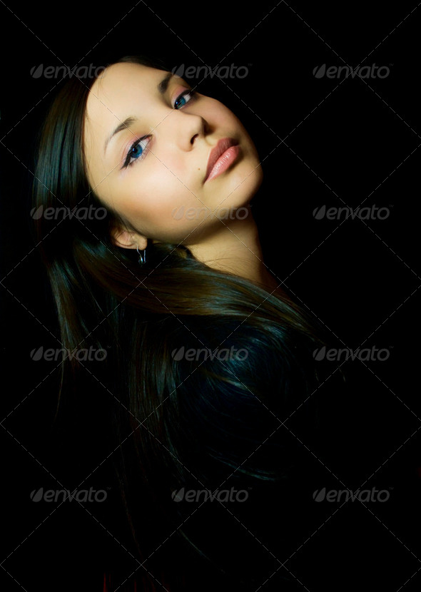 Portrait of a young beautiful woman - Stock Photo - Images