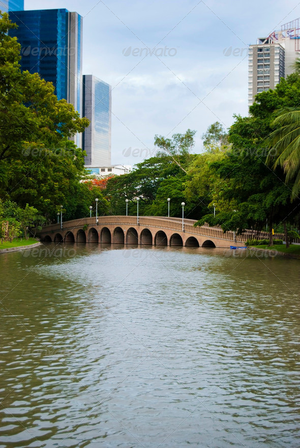 Bridge in a park in central Bangkok, Thailand - Stock Photo - Images