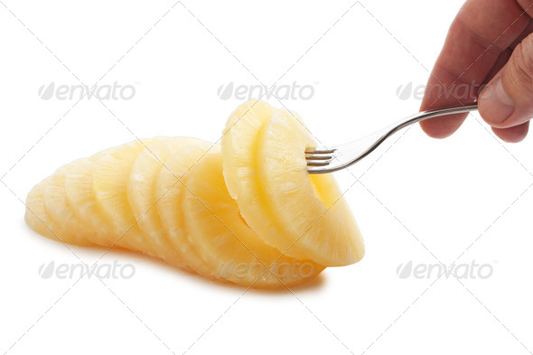 slice of pineapple on a fork - Stock Photo - Images