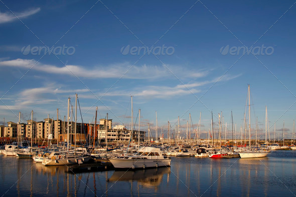 Yachts and boats in a marina at sunset - Stock Photo - Images