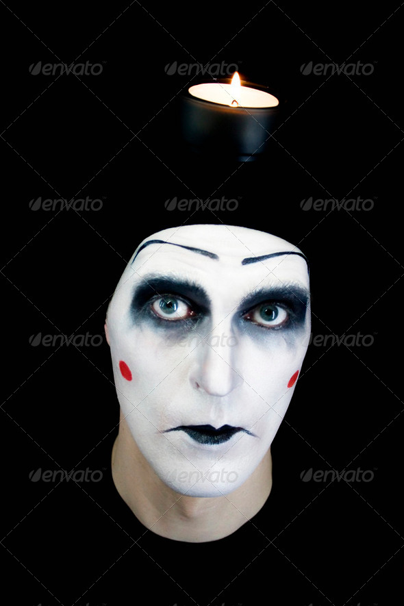 Mime and Candle - Stock Photo - Images