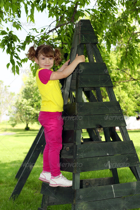 Little girl on playground posing - Stock Photo - Images