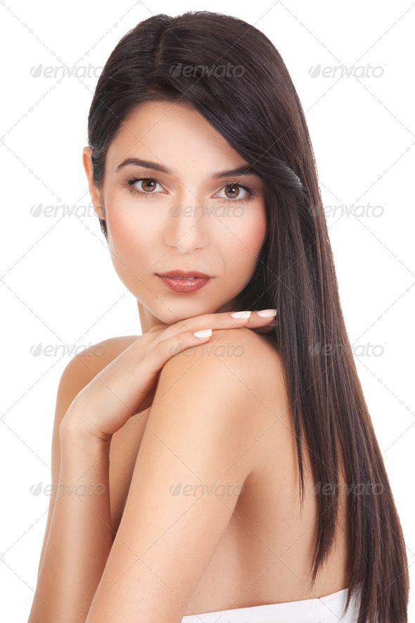 beauty portrait of a young woman, looking over her shoulder - Stock Photo - Images