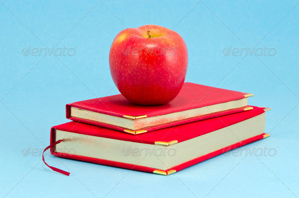 gilded business diary and red apple - Stock Photo - Images