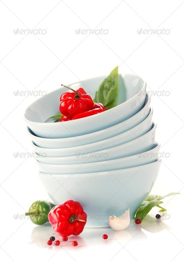 Stack of bowls and red peppers - Stock Photo - Images
