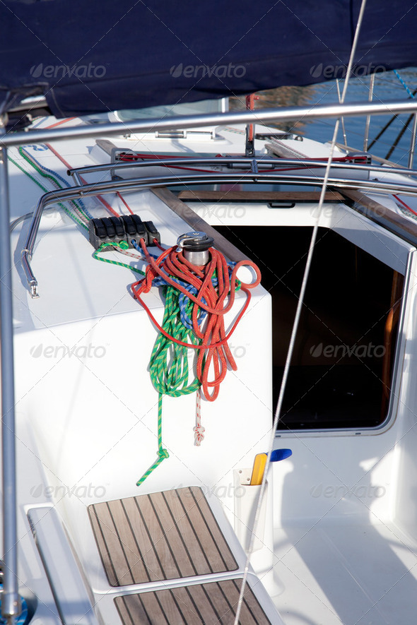 boat winches and sailboat ropes detail - Stock Photo - Images