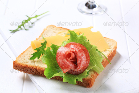 Bread with Swiss cheese and salami - Stock Photo - Images