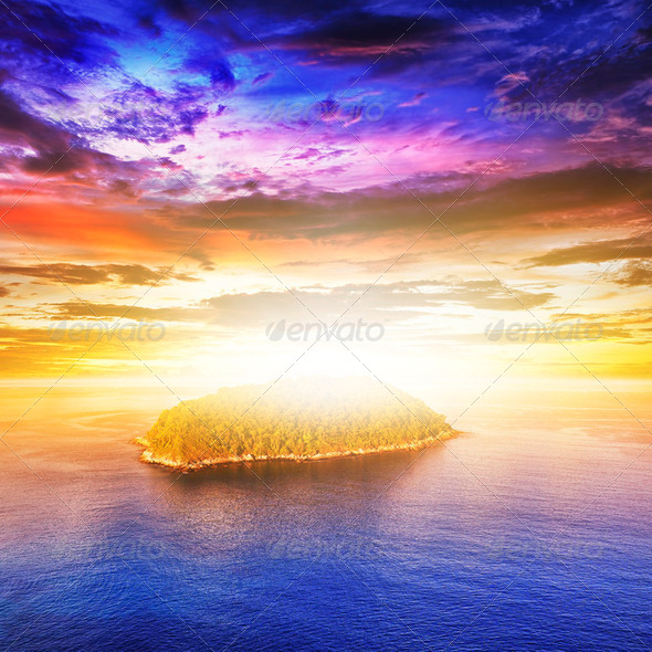 View of a tropical island at sunset - Stock Photo - Images
