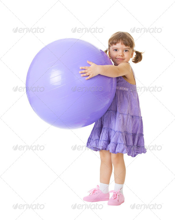 Little girl with a big purple ball - Stock Photo - Images
