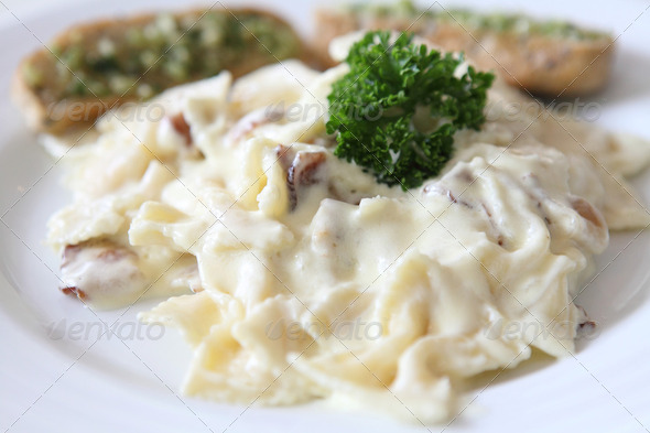 Farfalle pasta with white sauce and bacon - Stock Photo - Images