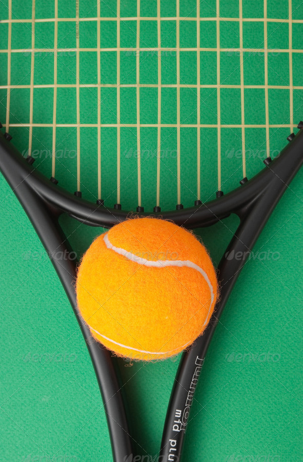 tennis racket and  ball on green background - Stock Photo - Images