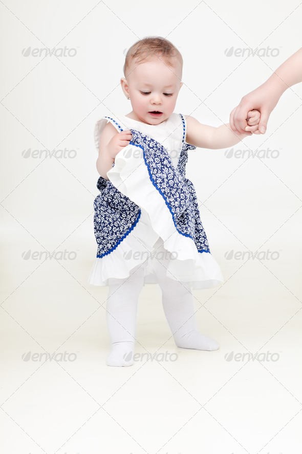 baby girl holding father hand - Stock Photo - Images
