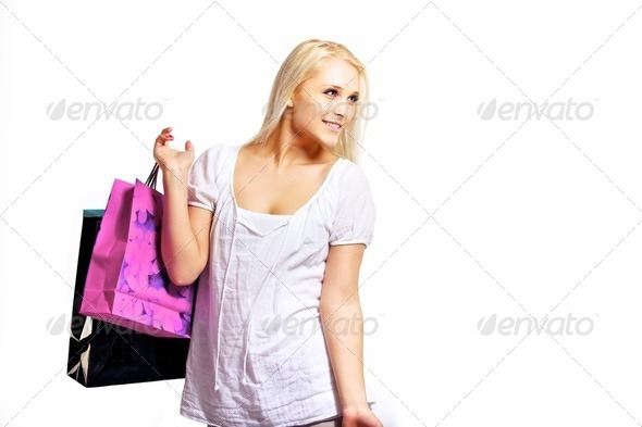 Happy woman holding shopping bags - Stock Photo - Images